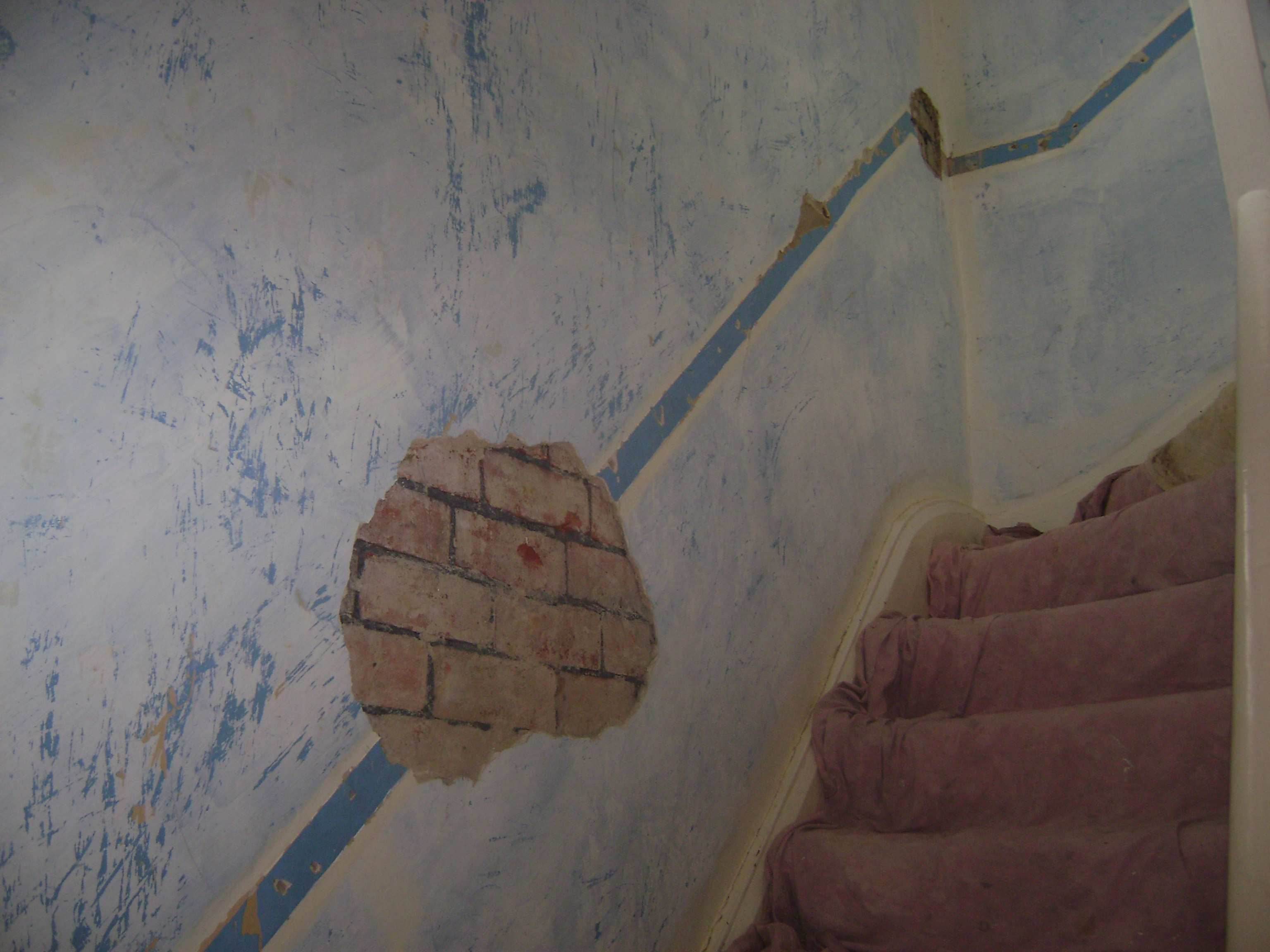 After the customer removed dado rail from this stairwell, a few sections of the wall were blown