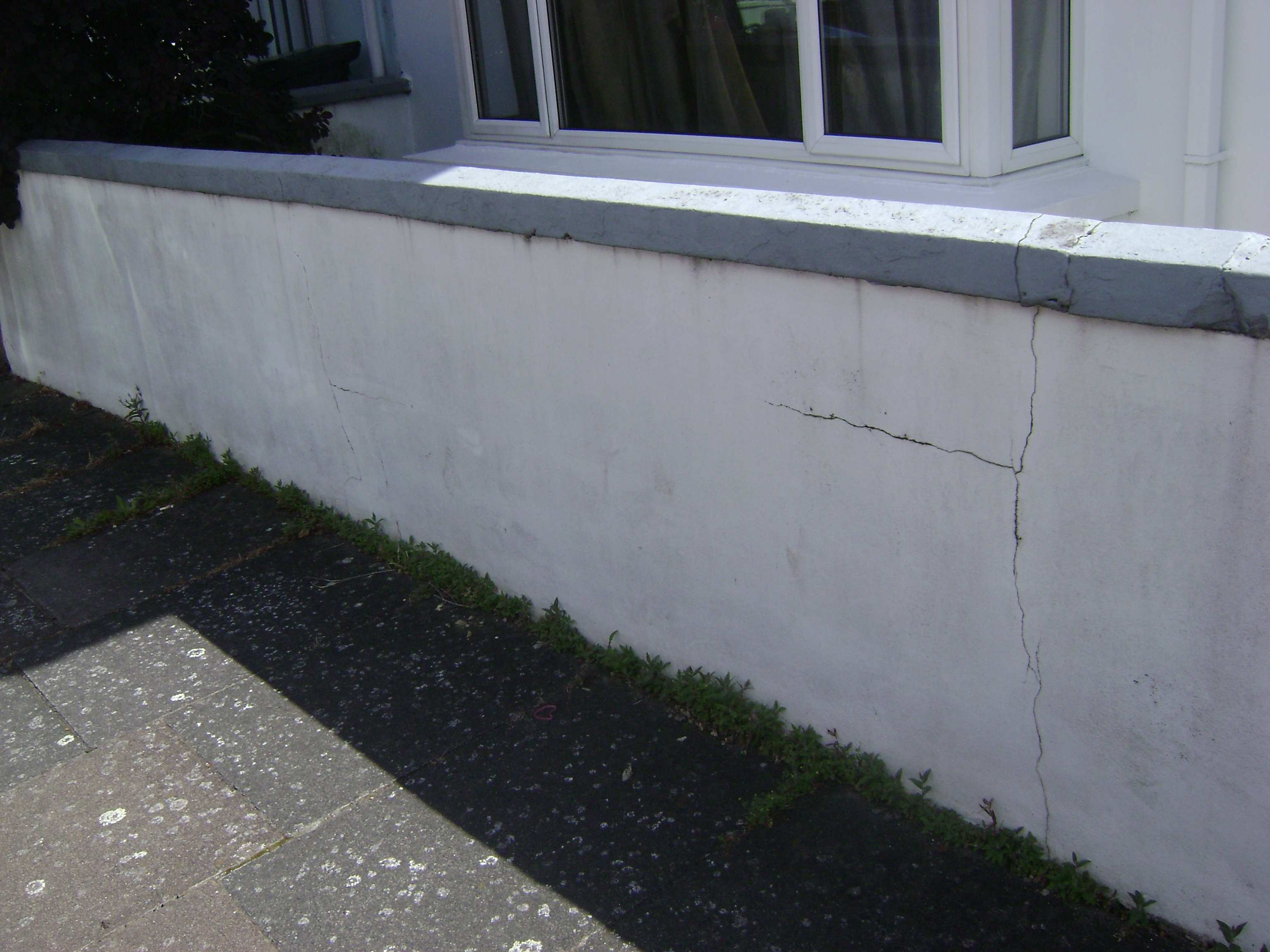 This garden wall had become badly cracked and blown over the years