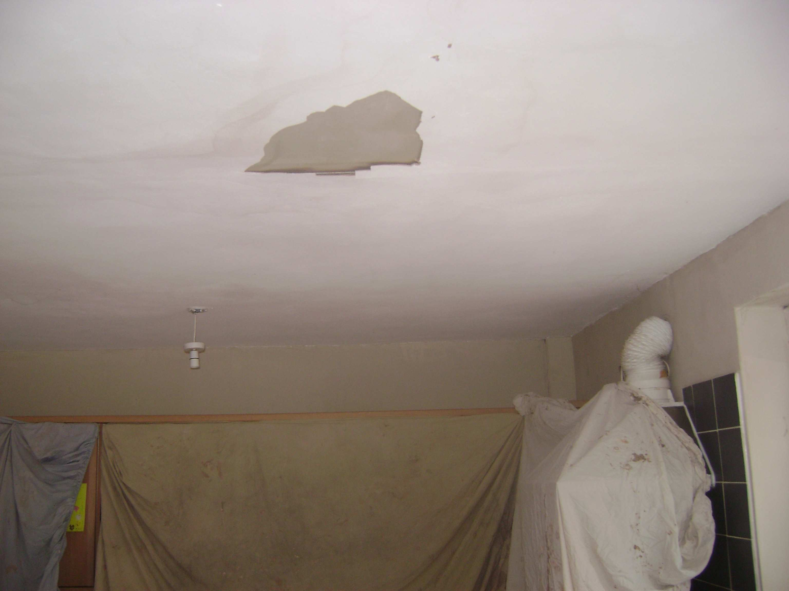This ceiling had been water damaged from a leaking pipe above and allowed to dry, causing the plaster to blow